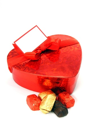 A shiny loveheart box of chocolates with blank gift label Stock Photo - 12361359