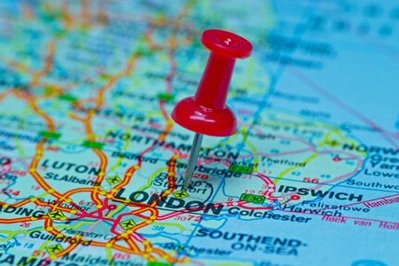 map pin: Macro image of a thumbtack pinned on a map - London