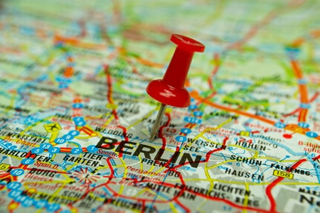Macro image of a thumbtack pinned on a map - Berlin photo