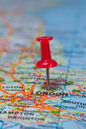 macro: Macro image of a thumbtack pinned on a map - London