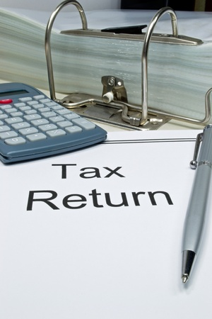 taxation: Tax return papers on a desk with copy space