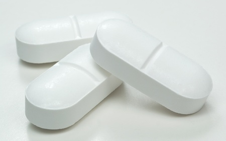 aspirin: Macro image of a group of white pharmaceutical  tablets