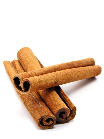 stick of cinnamon: Cinnamon sticks on a white background