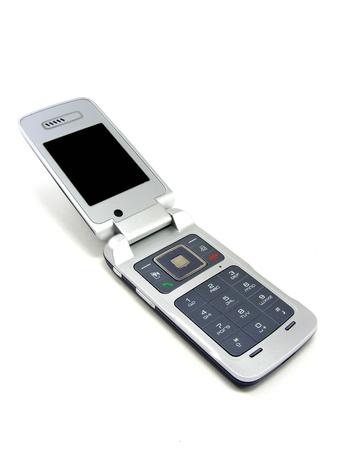 A flip cell mobile telephone on a white background photo