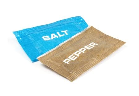 sachets: Salt and pepper sachets on a white background