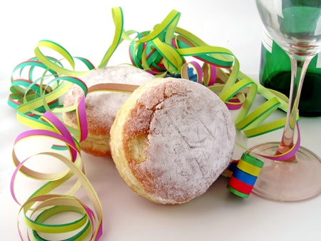 A food   drink new year party scene with traditional German jam filled doughnuts photo