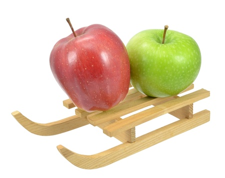 Two apples on a wooden sleigh Stock Photo - 13187882