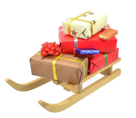 Christmas gifts and a sleigh on a white background photo