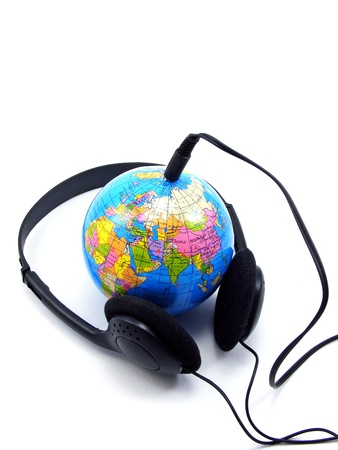 mp: Headphones plugged into a globe - Worldwide music concept Stock Photo