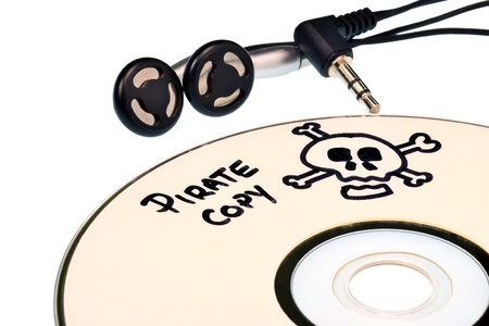 Music piracy with pirate copy cd and headphones Stock Photo - 13531765