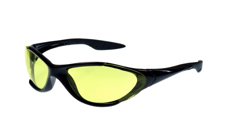 eye protection: A pair of sport sunglasses with yellow lenses on white background Stock Photo