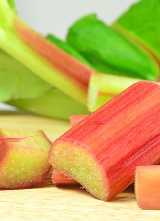rheum: Close up image of chopped rhubarb on wooden board Stock Photo