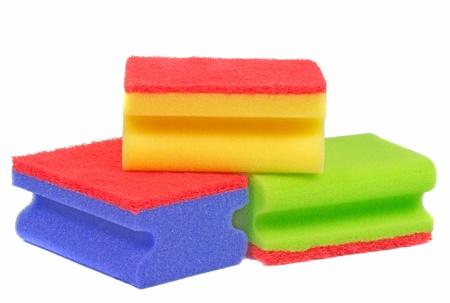 A selection of dish washing sponges on white background photo