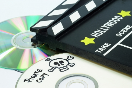 Pirate Copy written on a dvd next to a clapper board photo