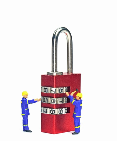 Security concept with engineers checking a combination padlock photo