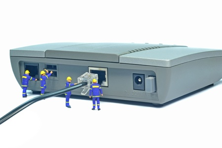 modem: Engineers repairing LAN internet connection on a router