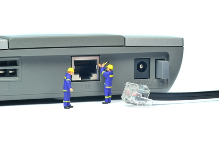 Engineers repairing LAN internet connection on a router photo