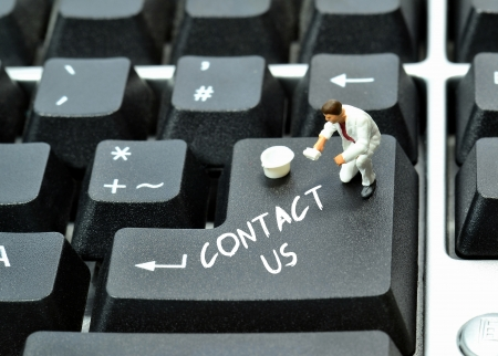 Contact us written on keyboard enter return button photo