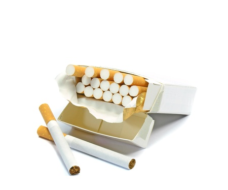 An open box of cigarettes on a white background with copy space photo
