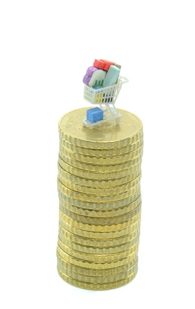Mini shopping cart trolley on a pile of coins Stock Photo - 16115935