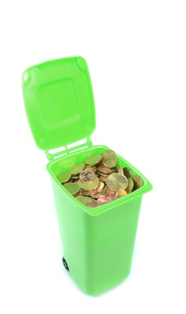A green recycling rubbish wheelie bin filled  with money photo