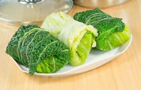 savoy: Savoy cabbage rolls stuffed and tied ready for cooking Stock Photo