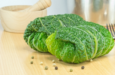 roulade: Savoy cabbage rolls stuffed and tied ready for cooking Stock Photo
