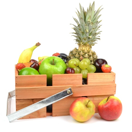 A wooden box crate of fresh fruit on white background photo