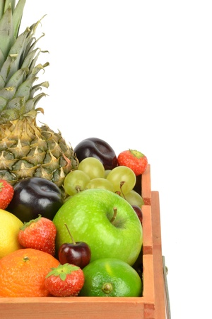 A selection of fresh fruit with white background copy space photo