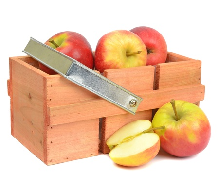 A wooden box crate with red apples on a white background photo