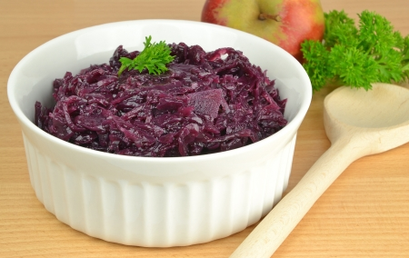 red cabbage: Cooked red cabbage in a white bowl on table top