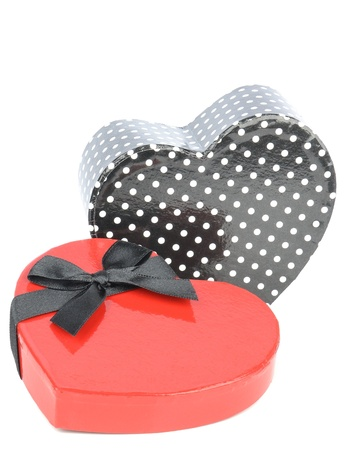A love heart shaped gift box with bow on white background Stock Photo - 17275710