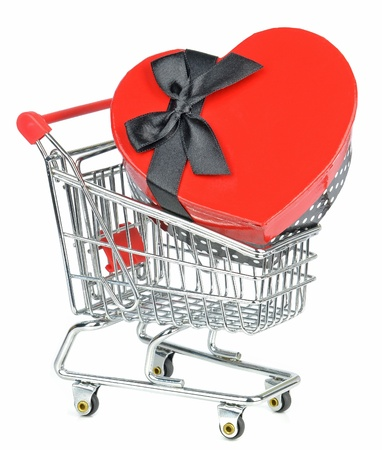 A love heart gift box in a shopping cart trolley on white background  Stock Photo - 17275729