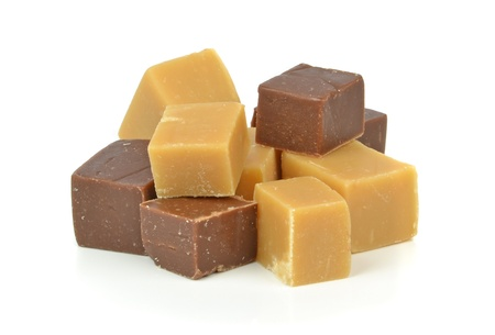 fudge: A pile of vanilla and chocolate fudge on a white background Stock Photo