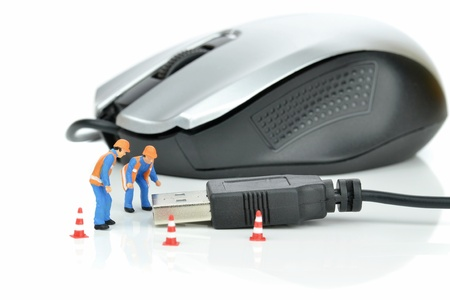 Engineers inspecting the usb plug of a computer mouse photo