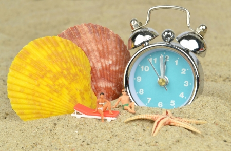 last minute: Last minute holiday concept with clock on the beach Stock Photo