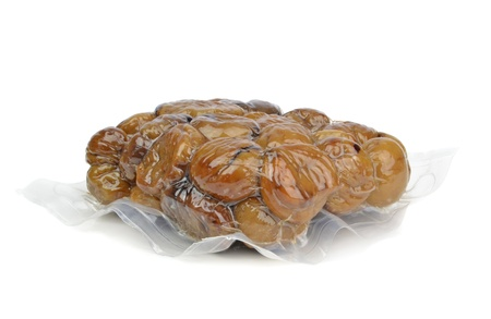 Vacuum packed chestnuts on a white background