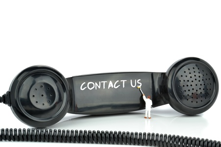 Contact us being painted on a telephone handset  Stock Photo - 18369863