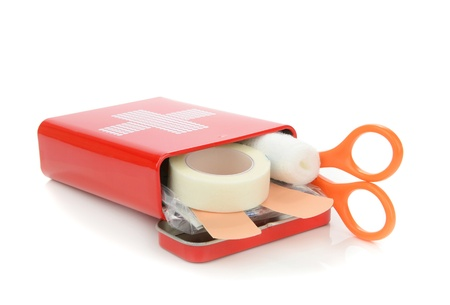 first aid box: An open travel first aid kit lying on a white background