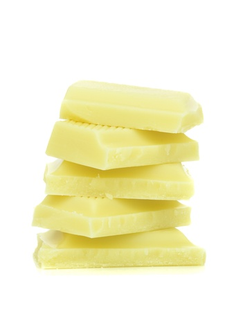chunk: A stack of white chocolate pieces on a white background Stock Photo