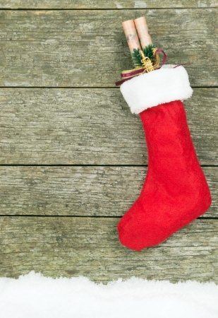 christmas sock: A Christmas stocking hanging on a wooden background