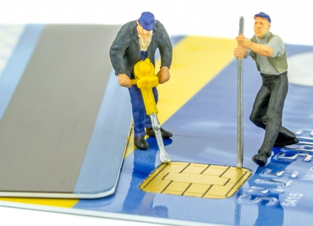 data theft: Credit card identity and data theft concept with miniature figures