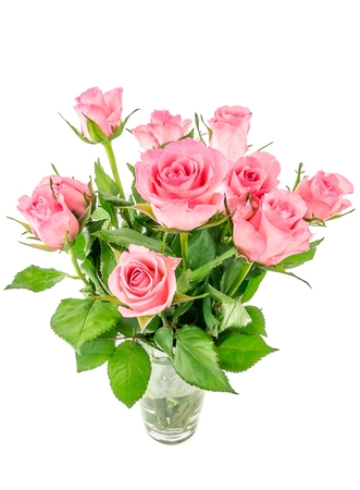A bunch of pink roses in a glass vase on white photo
