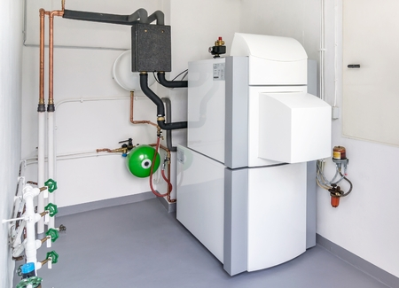 burner: A boiler room with a heating oil warm water system and pipes