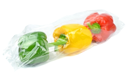 Fresh prepacked paprika peppers sealed in a cellophane bag  Stock Photo