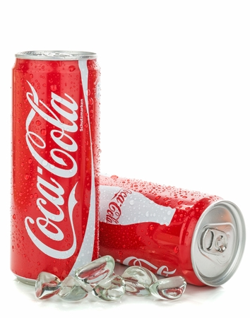 NIEDERSACHSEN, GERMANY AUGUST 10, 2014  Thin style 0,33 liter cans of coca cola soft drink with water droplets and ice on a white background