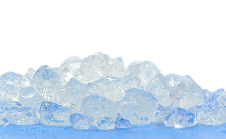crushed by: Chunks of crushed ice on blue surface and white background Stock Photo