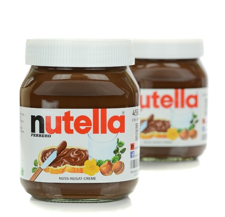 nutella: NIEDERSACHSEN, GERMANY SEPTEMBER 13, 2014: Two glass jars of Ferrero Nutella chocolate spread on a white background