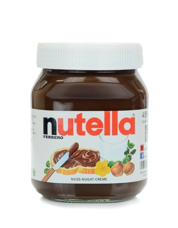known: NIEDERSACHSEN, GERMANY SEPTEMBER 13, 2014: A glass jar of Ferrero Nutella chocolate spread on a white background