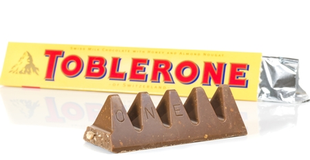 NIEDERSACHSEN, GERMANY OCTOBER 25, 2014: A bar of Toblerone milk cocolate on a white background